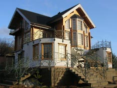 Деревянный каркасный дом, утепленный теплоизляцией Эковата
